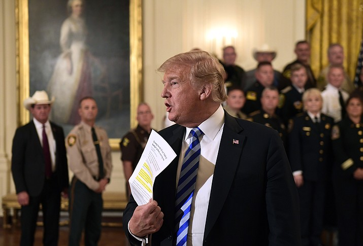 President Donald Trump responds to a reporters question during an event with sheriffs in the East Room of the White House in Washington, Wednesday, Sept. 5, 2018. (Susan Walsh/AP Photo)
