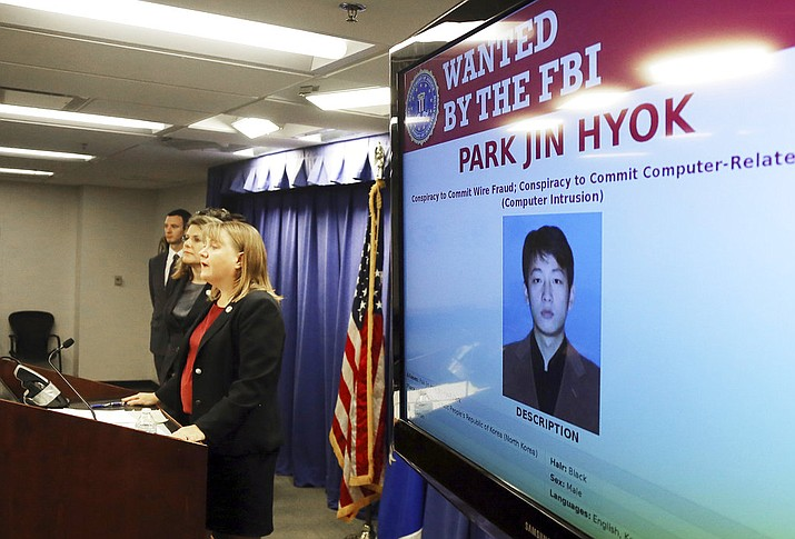 United States Attorney Tracy Wilkison announces a criminal complaint being filed against a North Korean national accused in a series of destructive cyberattacks around the world, at a news conference in Los Angeles Thursday, Sept. 6, 2018. The complaint alleges Park Jin Hyok, computer programmer accused of working at the behest of the North Korean government, was charged Thursday in connection with several high-profile cyberattacks, including the Sony Pictures Entertainment hack and the WannaCry ransomware virus that affected hundreds of thousands of computers worldwide. (AP Photo/Reed Saxon)