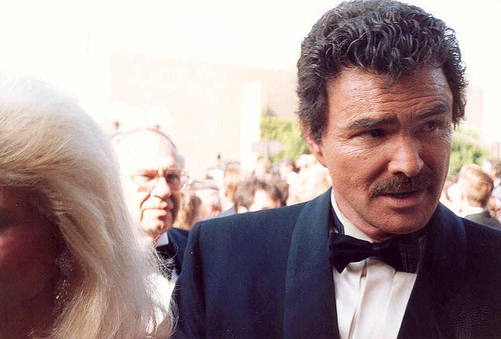 "Burt Reynolds, the handsome film and television star known for his acclaimed performances in ""Deliverance"" and ""Boogie Nights,"" commercial hits such as ""Smokey and the Bandit"" and for an active off-screen love life which included relationships with Loni Anderson and Sally Field, has died at age 82. (Photo by Alan Light [CC BY 2.0  (https://creativecommons.org/licenses/by/2.0)], via Wikimedia Commons)"