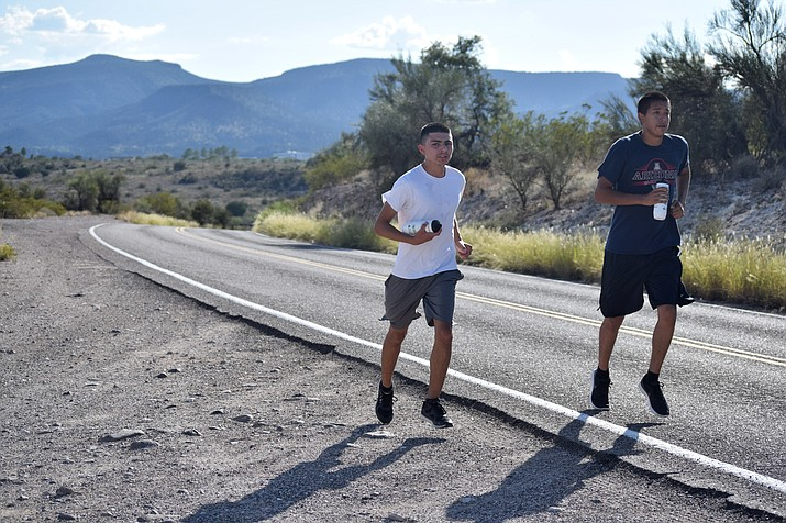 Camp Verde seniors Fabian Herrera Araiza (left) and Seth Jackson (right) run toward the Montezuma Castle National Monument on Wednesday at practice. VVN/James Kelley