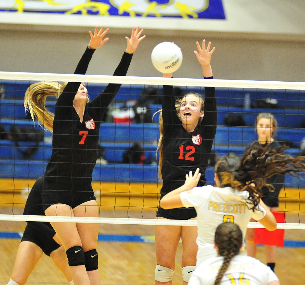 Bradshaw Mountain's Rylee Bundrick and Jordyn Moser go for a block as the Bears traveled to Prescott for a cross-town volleyball matchup against the Badgers Thursday Sept. 6, 2018. (Les Stukenberg/Courier)