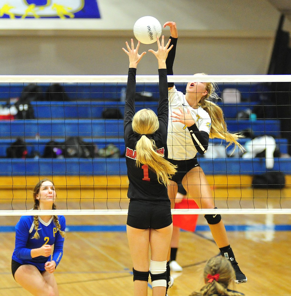 Prescott's Kathrine Radavich tries to slam through Shelbie Faughn as the Badgers hosted Bradshaw Mountain in a cross-town volleyball matchup Thursday Sept. 6, 2018. (Les Stukenberg/Courier)