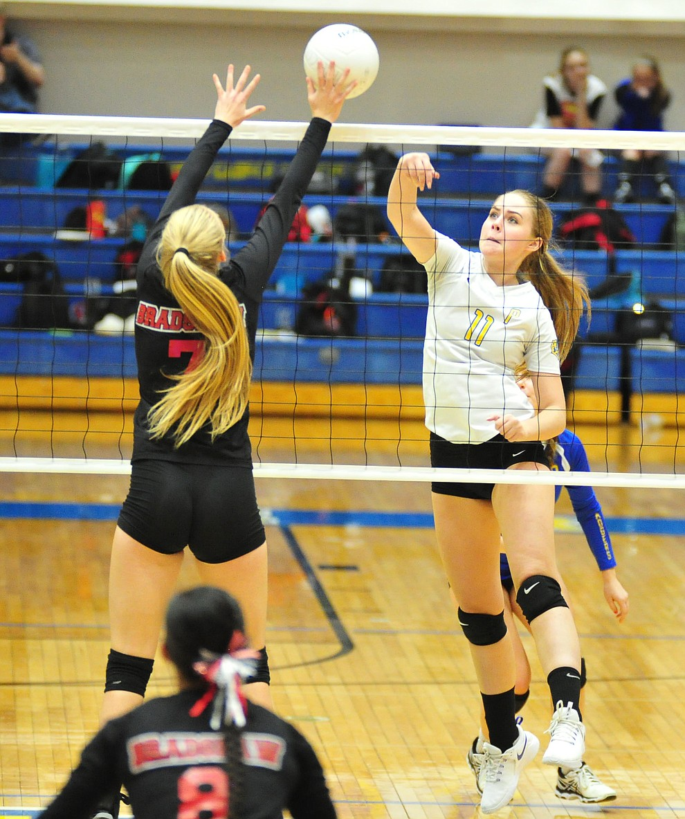 Prescott's Helen Burger tries to go over Rylee Bundrick as the Badgers hosted Bradshaw Mountain in a cross-town volleyball matchup Thursday Sept. 6, 2018. (Les Stukenberg/Courier)