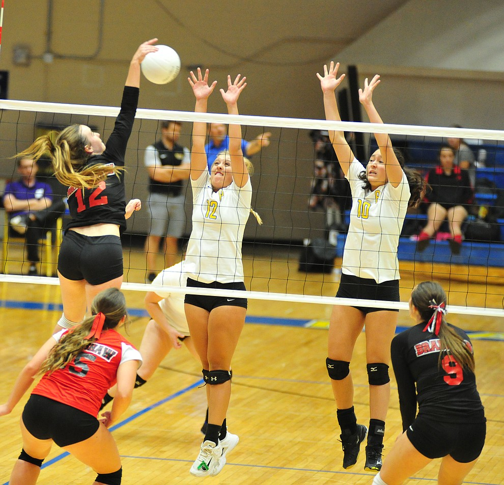 Bradshaw Mountain's Jordyn Moser tries to split Tessandra Rothfuss and Meleya Resnick as the Bears traveled to Prescott for a cross-town volleyball matchup against the Badgers Thursday Sept. 6, 2018. (Les Stukenberg/Courier)