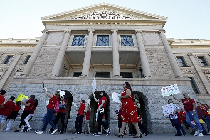 Arizona teachers and education advocates march in front of the Arizona Capitol highlighting low teacher pay and school funding in Phoenix. (Ross D. Franklin/AP)