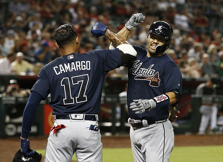 Atlanta Braves' Kurt Suzuki, right, celebrates his two-run home run against the Arizona Diamondbacks with Johan Camargo (17) during the fourth inning of a baseball game Thursday, Sept. 6, 2018, in Phoenix. (Ross D. Franklin/AP)