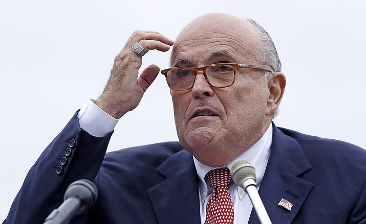 Rudy Giuliani, an attorney for President Donald Trump, addresses a gathering during a campaign event Aug. 1, 2018, for Eddie Edwards, who is running for the U.S. Congress, in Portsmouth, N.H. President Trump will not answer any questions, written or in-person, about possible obstruction of justice, Giuliani told The Associated Press. (Charles Krupa, AP Photo File)