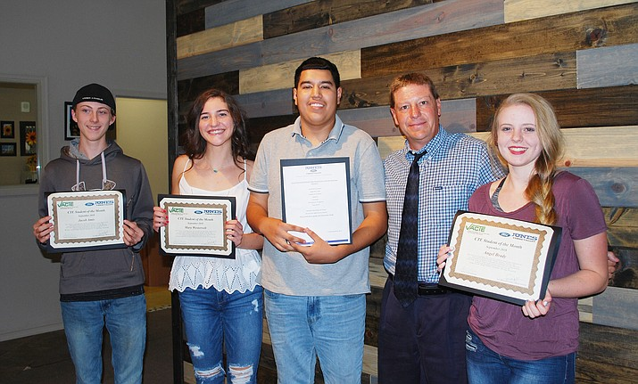 At its Sept. 4 meeting, the Valley Academy of Career and Technology Education Superintendent Bob Weir presented the program's September 2018 Student of the Month awards to Mingus Union High School automotive student Jacob Amis, Sedona-Red Rock High School sports medicine student Mary Westervelt, Valley Academy construction student Luis Rivera and Camp Verde High School graphic and web design student Angel Brady, from left. Photo courtesy VACTE