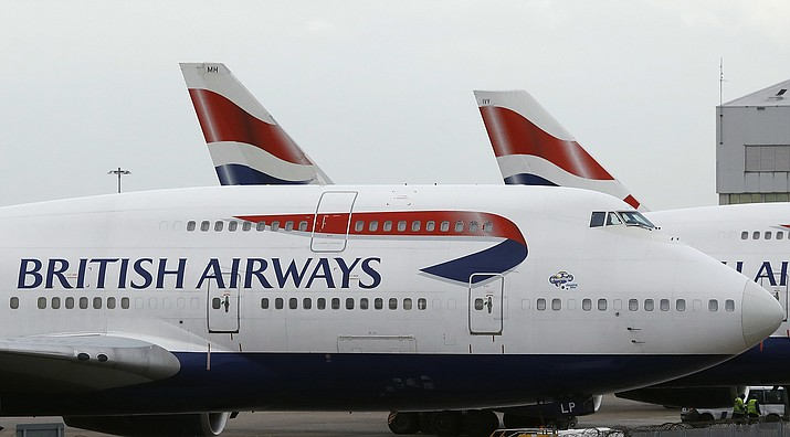 "FILE - In this file photo dated Tuesday, Jan. 10, 2017, British Airways planes are parked at Heathrow Airport in London.  British Airways announced a ""very sophisticated malicious criminal attack"" on its website Thursday Sept. 6, 2018, that compromised personal credit card information of its customers, and Chief Executive Alex Cruz said Friday the company is ""100 percent committed"" to compensating customers whose financial information was stolen. (AP Photo/Frank Augstein, FILE)"