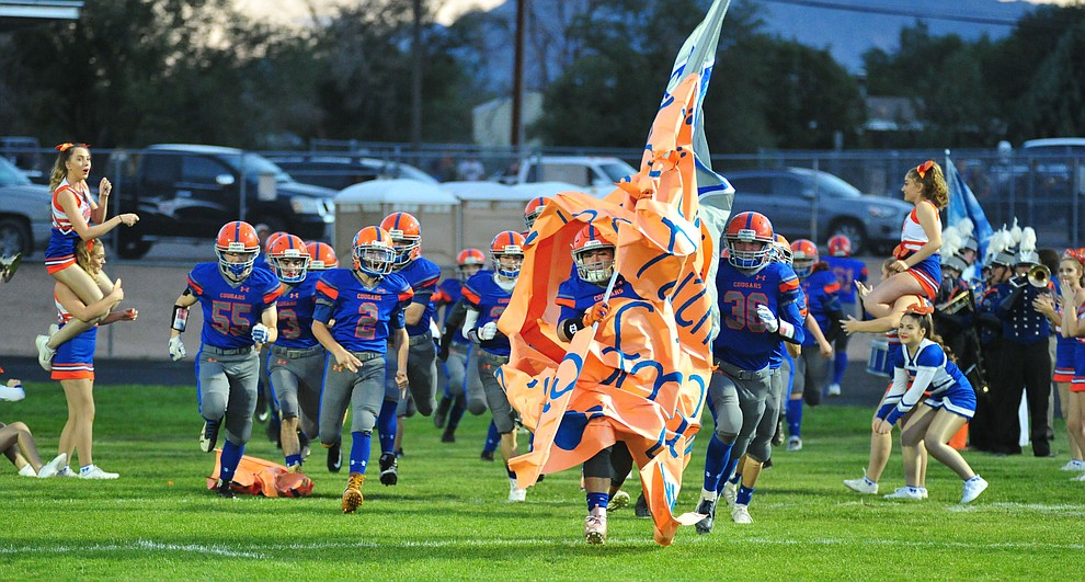 Chino Valley palyers take the field as they host Camp Verde in the annual Copper Boot game Friday Sept. 7, 2018 in Chino Valley. (Les Stukenberg/Courier)