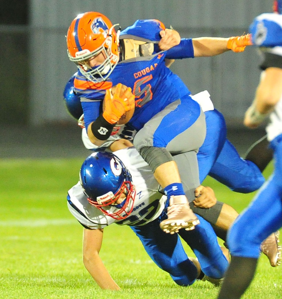 Chino Valley's Mikey Paulus runs hard as they host Camp Verde in the annual Copper Boot game Friday Sept. 7, 2018 in Chino Valley. (Les Stukenberg/Courier)