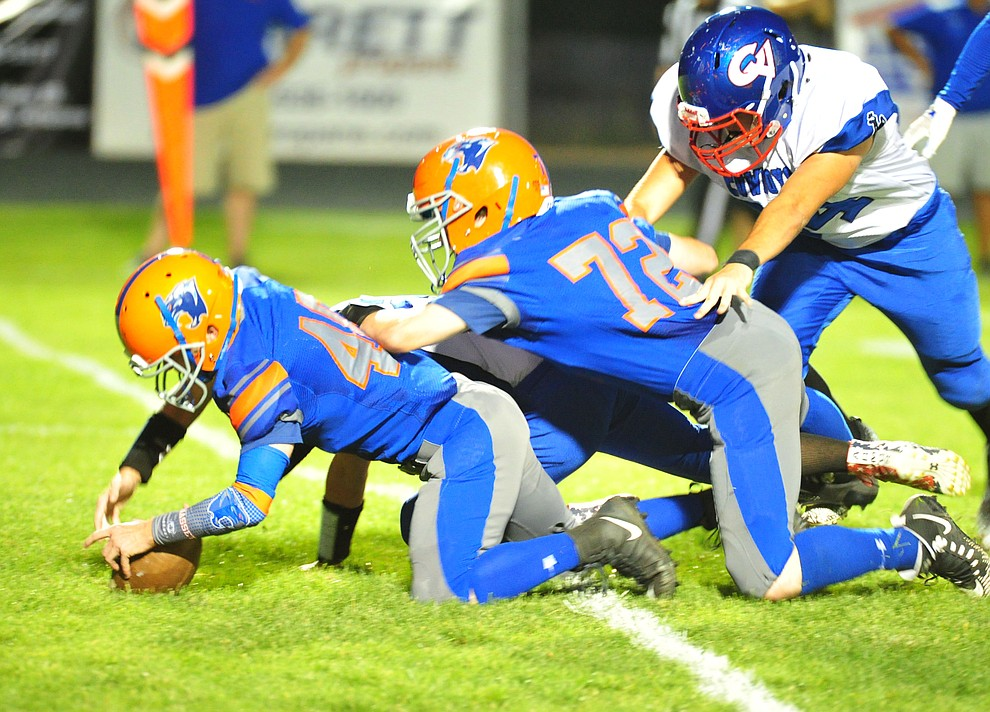 Chino Valley's Ty Bassett recovers a fumble as they host Camp Verde in the annual Copper Boot game Friday Sept. 7, 2018 in Chino Valley. (Les Stukenberg/Courier)