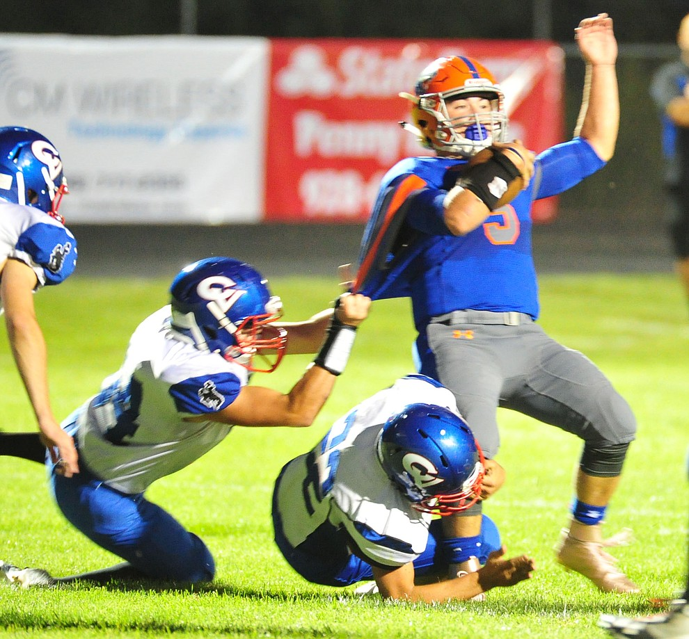 Chino Valley's Mikey Paulus gets hauled down as they host Camp Verde in the annual Copper Boot game Friday Sept. 7, 2018 in Chino Valley. (Les Stukenberg/Courier)