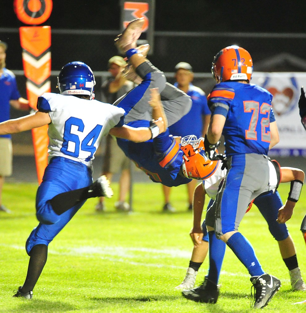 Chino Valley's Mikey Paulus goes up and over for a touchdown, his second of the night, as the Cougars host Camp Verde in the annual Bronze Boot game Friday, Sept. 7, 2018, in Chino Valley. (Les Stukenberg/Courier)