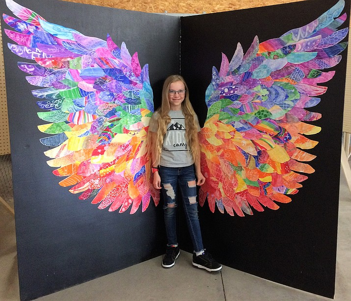 Perfect photo opportunities exist at the Yavapai County Fair art exhibit, as Adessa Kunzmann, 10, demonstrates here with angel wings. The Fair runs through Sunday, Sept. 9, at the Prescott Rodeo Grounds.
