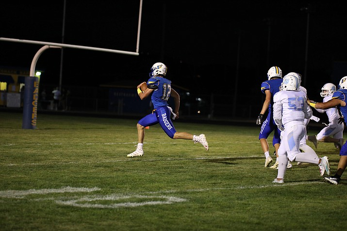 Prescott quarterback Austin Clark (12) sprints across the goal line for a touchdown, one of his school-record seven rushing touchdowns in a 56-7 win over Deer Valley on Friday, Sept. 7, 2018, in Prescott. (Jim Clark/Courtesy)