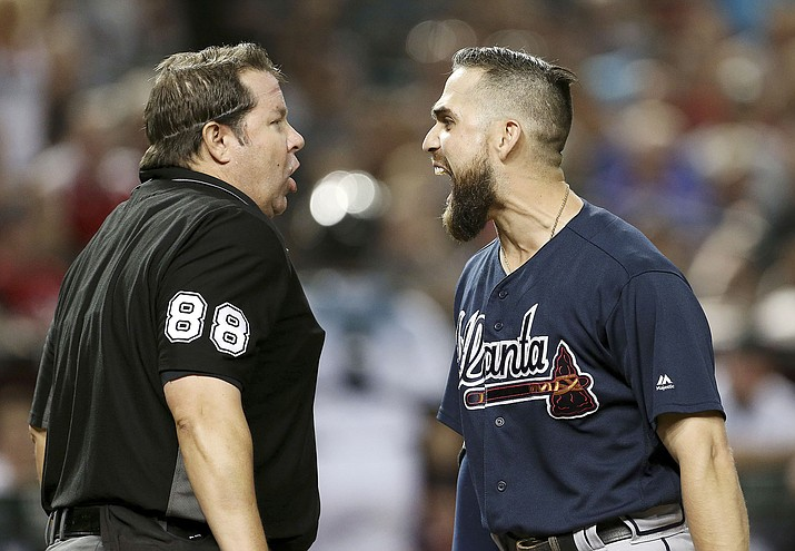Atlanta Braves' Ender Inciarte, right, argues with home plate umpire Doug Eddings after striking out against the Arizona Diamondbacks during the fourth inning Friday night. (Ralph Freso/AP)