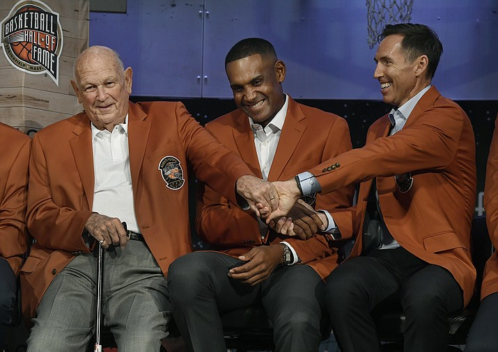 "Class of 2018 inductees into the Basketball Hall of Fame, from right, Steve Nash, Grant Hill, and Charles ""Lefty"" Driesell grasp hands during a news conference at the Naismith Memorial Basketball Hall of Fame, Thursday, Sept. 6, 2018, in Springfield, Mass. (Jessica Hill/AP)"