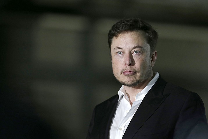 In this June 24, 2018, file photo Tesla CEO and founder of the Boring Company Elon Musk speaks at a news conference in Chicago. Shares of electric car maker Tesla Inc. tumbled over 9 percent after the CEO smoked marijuana during a YouTube video. (Kiichiro Sato/AP, File)