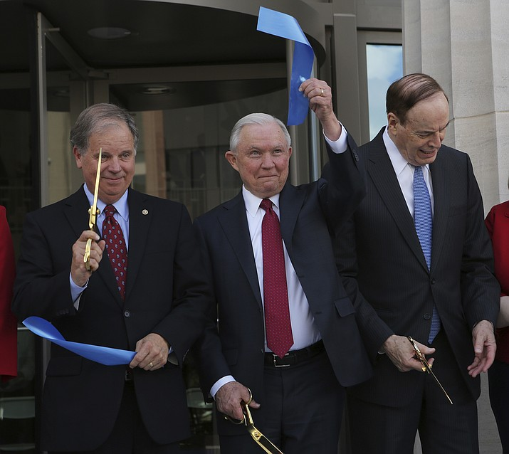 U.S. Sen. Doug Jones, D-Ala., left, Attorney General Jeff Sessions, center, and U.S. Sen. Richard Shelby, R-Ala., react at the ribbon cutting ceremony for the United States Courthouse for the Southern District of Alabama Friday, Sept. 7, 2018, in Mobile, Ala. (Dan Anderson/AP)