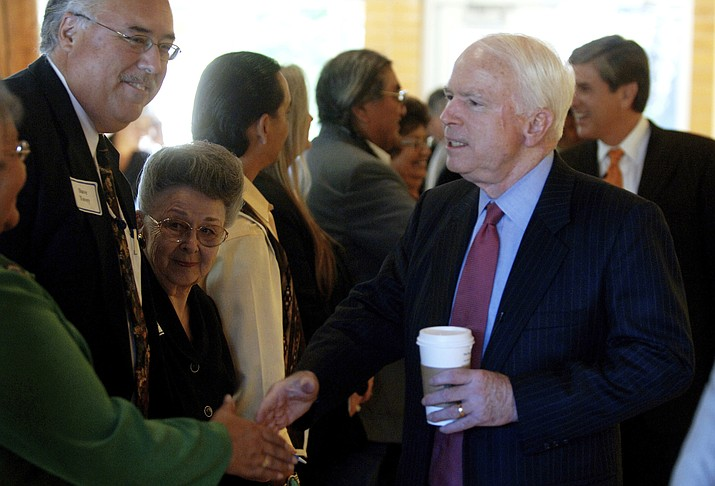 In a Oct. 24, 2005 file photo, Sen. John McCain, R-Ariz., greets representatives from the nine Oregon tribes, during a meeting at the Native American Studies and Cultural Center in Portland, Ore. (Jamie Francis/The Oregonian via AP, File)