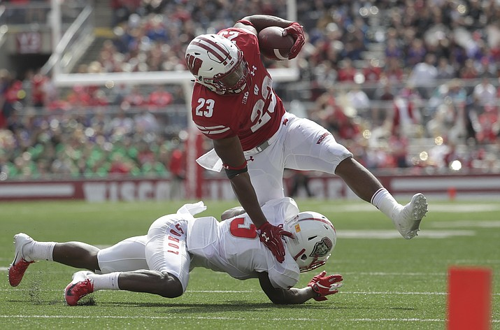 Wisconsin's Jonathan Taylor runs over New Mexico's Michael Sewell Jr. during the second half of an NCAA college football game Saturday, Sept. 8, 2018, in Madison, Wis. Wisconsin won 45-14. (Morry Gash/AP)