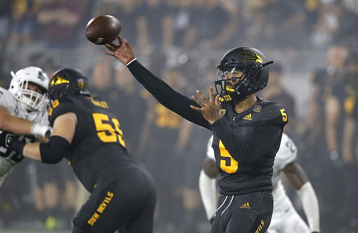 Arizona State quarterback Manny Wilkins (5) throws a pass against Michigan State during the first half of an NCAA college football game Saturday, Sept. 8, 2018, in Tempe, Ariz. (Ross D. Franklin/AP)