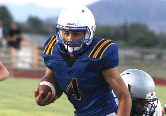 Kingman's Austin Dias rushed for 114 yards and one touchdown Friday night in a 46-3 win over Valley Lutheran. The Bulldogs put up 404 yards of total offense. (Daily Miner file photo)
