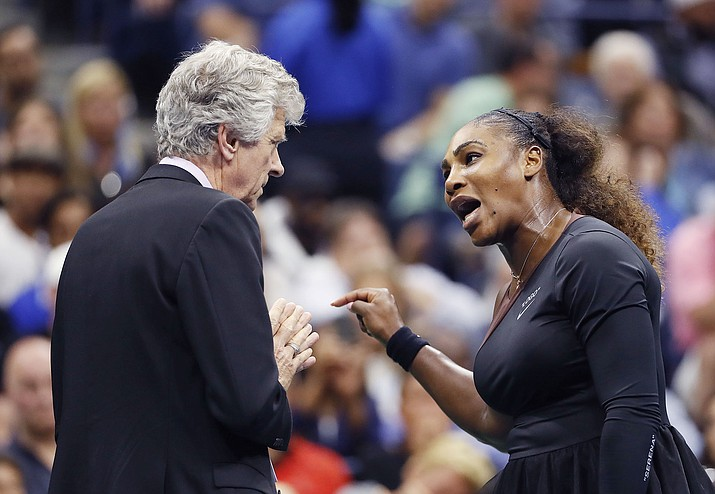 Serena Williams talks with referee Brian Earley during the women's final of the U.S. Open tennis tournament against Naomi Osaka, of Japan, Saturday, Sept. 8, 2018, in New York. (Adam Hunger/AP)