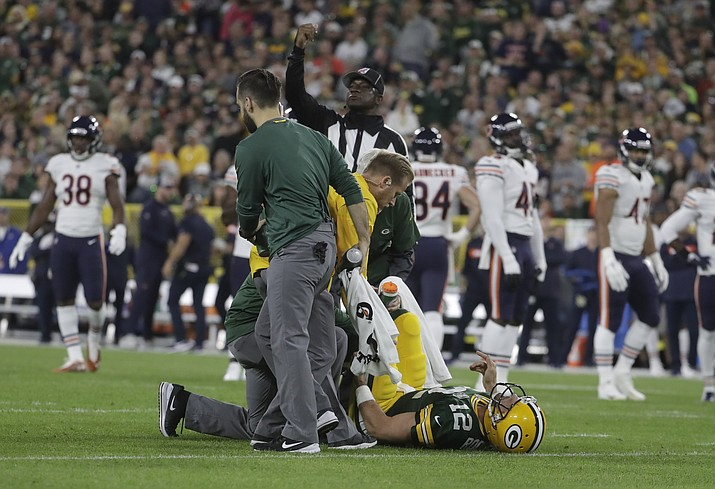Green Bay Packers quarterback Aaron Rodgers is hurt after being sacked during the first half of an NFL football game against the Chicago Bears Sunday, Sept. 9, 2018, in Green Bay, Wisconsin. (Morry Gash/AP Photo)