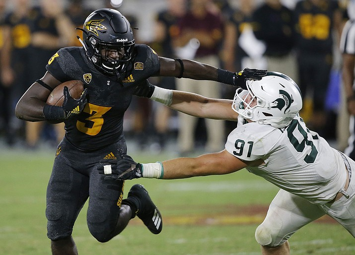 Arizona State running back Eno Benjamin (3) gives Michigan State defensive end Jack Camper (91) a stiff arm as he tries to get past during the second half of an NCAA college football game Saturday, Sept. 8, 2018, in Tempe, Ariz. Arizona State defeated Michigan State 16-13. (Ross D. Franklin/AP Photo)