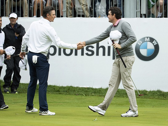Justin Rose, of England, left, and Keegan Bradley shakes hands after the BMW Championship golf tournament at the Aronimink Golf Club, Monday, Sept. 10, 2018, in Newtown Square, Pennsylvania. Bradley held off Rose in a sudden-death playoff to win the rain-plagued BMW Championship for his first PGA Tour victory in six years. (Chris Szagola/AP Photo)