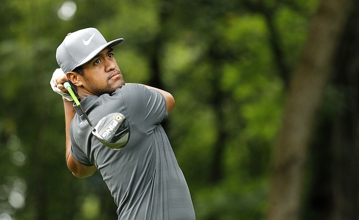 Tony Finau hits on the 17th tee during a practice round for the PGA Championship golf tournament at Bellerive Country Club in St. Louis, April 7, 2018. (Charlie Riedel/AP Photo, file)