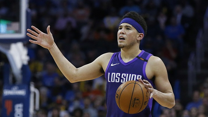 Phoenix Suns guard Devin Booker during an NBA basketball game against the Oklahoma City Thunder in Oklahoma City, Thursday, March 8, 2018. (Sue Ogrocki/AP Photo file)