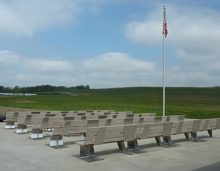 Benches on the Arrival Court of the Memorial Plaza at the Flight 93 National Memorial. The white marble Wall of Names is on the upper left.   (Photo by James Steakley [CC BY-SA 3.0  (https://creativecommons.org/licenses/by-sa/3.0) or GFDL (http://www.gnu.org/copyleft/fdl.html)], from Wikimedia Commons)