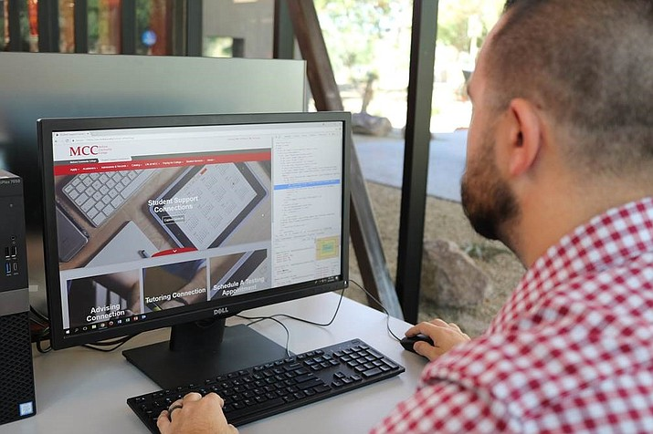 MCC Web and Application Developer Michael Gaffney working on the Student Support Connections platform he helped create for the college. (Photo courtesy Mohave Community College)