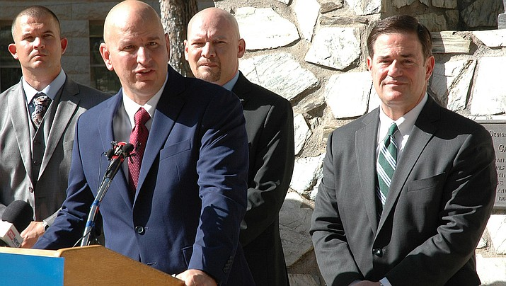 Brandon Judd, president of the National Border Patrol Council, explains Monday why his group supports the bid of Gov. Doug Ducey, looking on, in his bid for re-election. (Capitol Media Services photo by Howard Fischer)