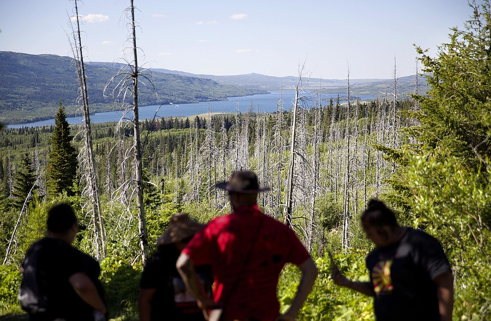 Searchers pause against the scenery while looking for clues in the disappearance of Ashley HeavyRunner Loring, who has been missing for over a year from the Blackfeet Indian Reservation in Babb, Mont., Thursday July 12, 2018. Ashley's disappearance is one small chapter in what one senator calls an epidemic, the unsettling story of missing and murdered Native American women and girls. No one knows precisely how many there are in the U.S., partly because some go unreported and others haven't been accurately documented. (AP Photo/David Goldman)