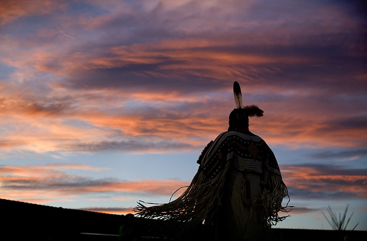 A woman performs a traditional Native American dance during the North American Indian Days celebration on the Blackfeet Indian Reservation in Browning, Montana. (AP Photo/David Goldman)