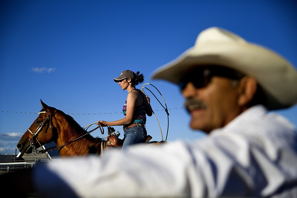 A female contestant waits to rope a calf during a practice run for a rodeo competition on the Blackfeet Indian Reservation in Browning, Mont., Tuesday, July 10, 2018. A 2017 analysis by Montana's Department of Justice found Native Americans account for 30 percent of missing girls and women _ 22 of 72 _ even though they represent only 3.3 percent of the state's population. (AP Photo/David Goldman)