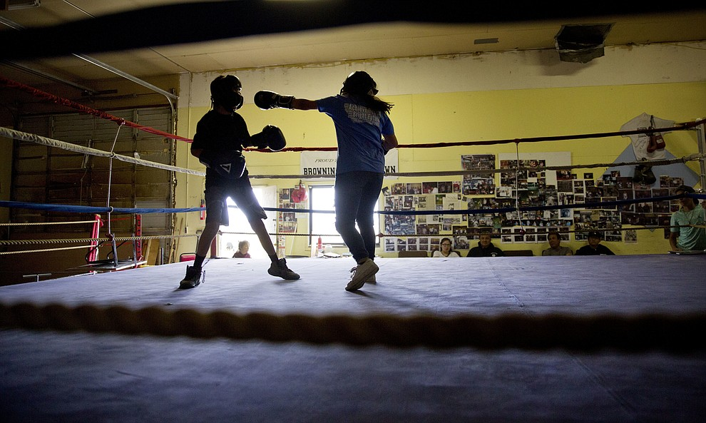 "Beatrice Kipp, 13, right, spars with Timmy Sellars, 14, at the Blackfeet Native Boxing Club on the Blackfeet Indian Reservation in Browning, Mont., Saturday, July 14, 2018. ""I'm protective of our children because of human trafficking. What happened to Ashley is really worrying,"" said Frank Kipp who teaches his daughters how to box and runs the club. ""We teach our girls if someone grabs you, you fight to your death."" (AP Photo/David Goldman)"