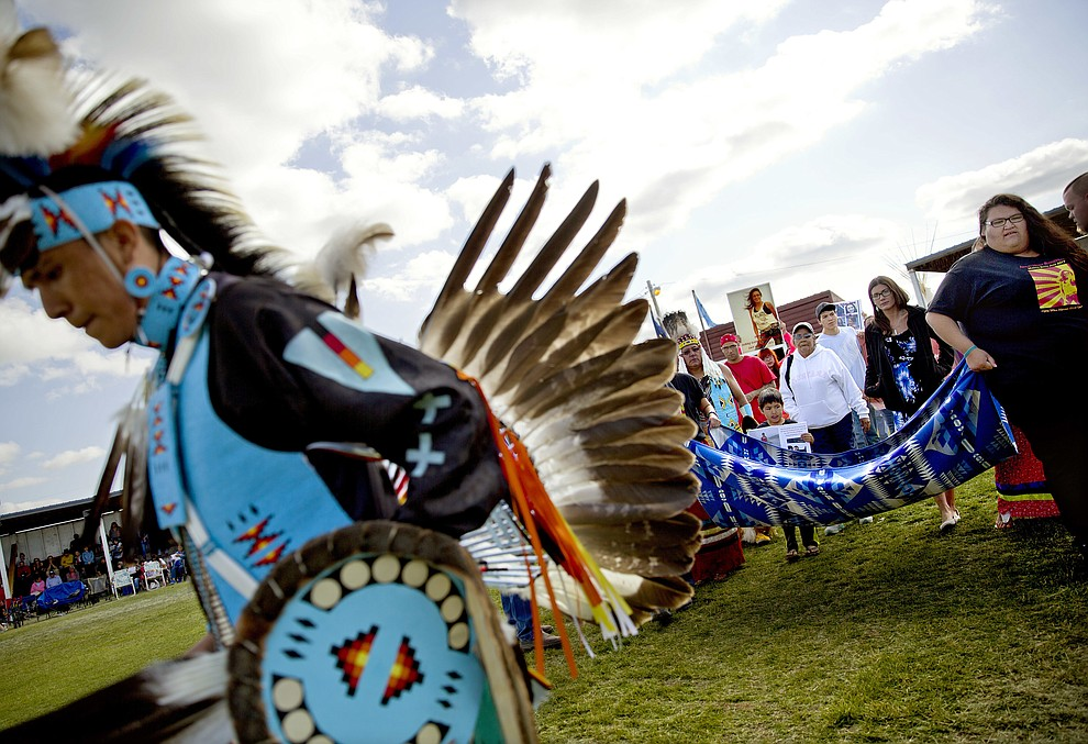 Friends and family members of Ashley HeavyRunner Loring hold a traditional blanket dance before the crowd at the North American Indian Days celebration to raise awareness and funds for her search on the Blackfeet Indian Reservation in Browning, Mont., Saturday, July 14, 2018. In January, the FBI took over the case after a tip led investigators off the reservation and into another state. A $10,000 reward is being offered in the case. (AP Photo/David Goldman)