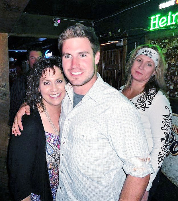 Jaye Lene Cornell Long, left, poses with her son Brandon Selinsky, center, while Brandon's sister Cassie Bertella, right, looks on. Two weeks ago, Brandon took his own life while on active military duty in Colorado — just a year and a half after the 2017 suicide of his identical twin brother, Travis Selinsky. (Jaye Lene Cornell Long/Courtesy)