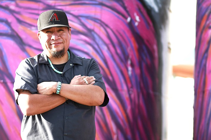 Jerrel Singer is a Native artist who paints murals in northern Arizona and along Highway 89 outside of Gray Mountain. The murals reflect some of the issues faced by the Navajo people and others including uranium mining. (Loretta Yerian/NHO)