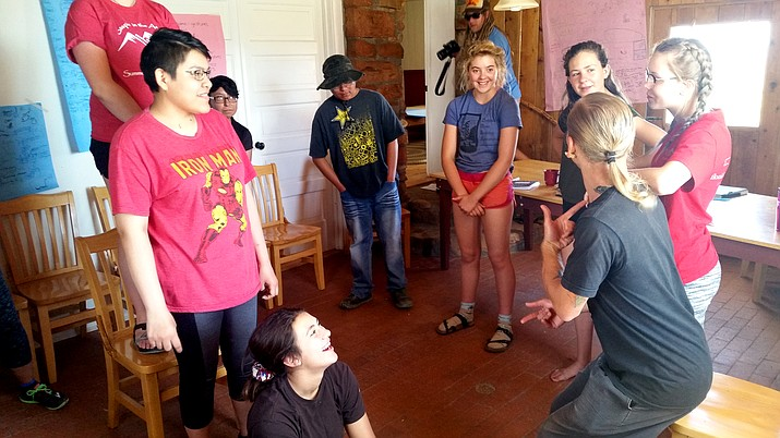 Sherrissa Brown and Rebecca Encinas participate in a workshop exercise led by Tyler Norman.
