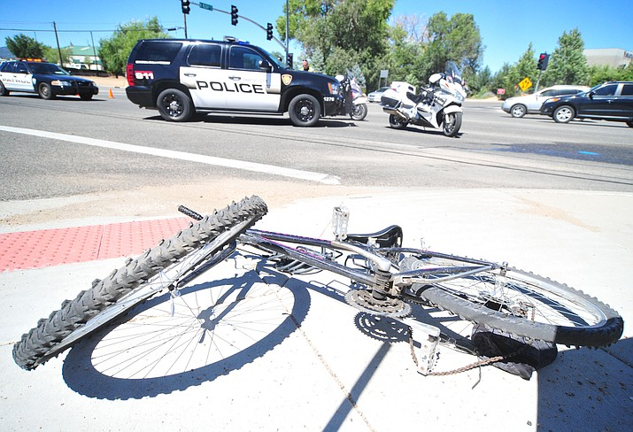A damaged bicycle lies on a sidewalk at the intersection of Sheldon and Rush streets in Prescott shortly after its rider was run over by a City of Prescott vehicle Tuesday, Sept. 11.