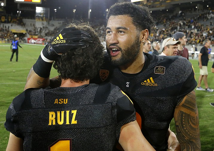 Arizona State place kicker Brandon Ruiz (1) celebrates his game-winning field goal against Michigan State with Arizona State linebacker Jay Jay Wilson, right, after a college football game Saturday, Sept. 8, 2018, in Tempe. Arizona State defeated Michigan State 16-13. (Ross D. Franklin/AP, file)