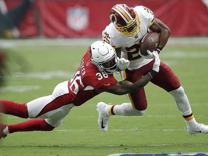Washington Redskins running back Chris Thompson is hit by Arizona Cardinals defensive back Budda Baker during the first half of their game, Sunday, Sept. 9, 2018, in Glendale, Ariz. (Ross D. Franklin/AP Photo)