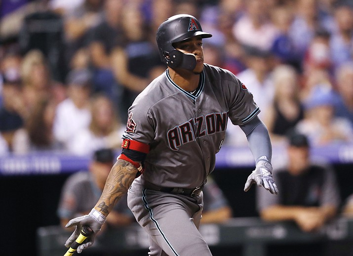 Arizona Diamondbacks' Ketel Marte follows the flight of his triple to drive in two runs off Colorado Rockies starting pitcher Antonio Senzatela in the sixth inning of a baseball game, Tuesday, Sept. 11, 2018, in Denver. (David Zalubowski/AP)