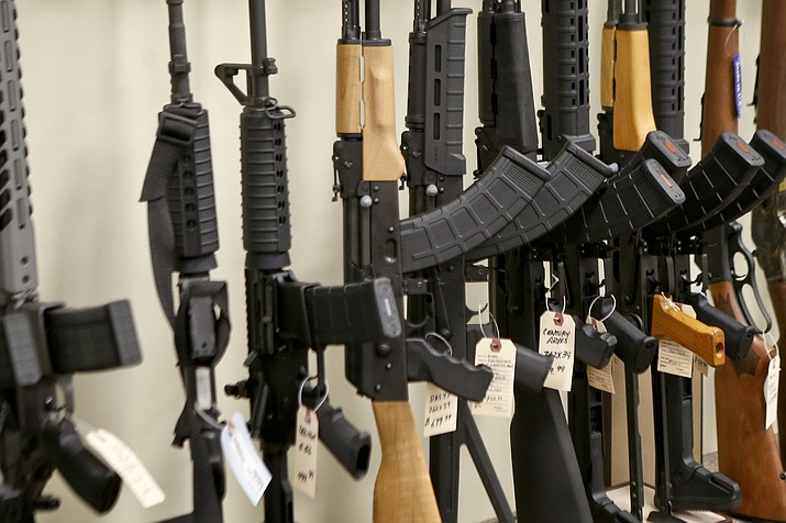 Various models of semi-automatic rifles are on display at a store in Pennsylvania on March 1, 2018. Research published Tuesday, Sept. 11, 2018 in the Journal of the American Medical Association shows active shooters with semi-automatic rifles wound and kill twice as many people as those using non-automatic weapons. (Keith Srakocic/AP Photo File)